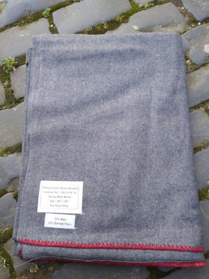 Military style blanket, heavy wool blend. Handy for camping, fishing, or standard scout camp blanket.