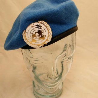 United Nations beret and enamel badge